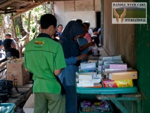 Pharmacists distribute free medicine to the impoverished