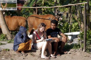 An Aid Trip participant works with a translator to examine the needs of the community