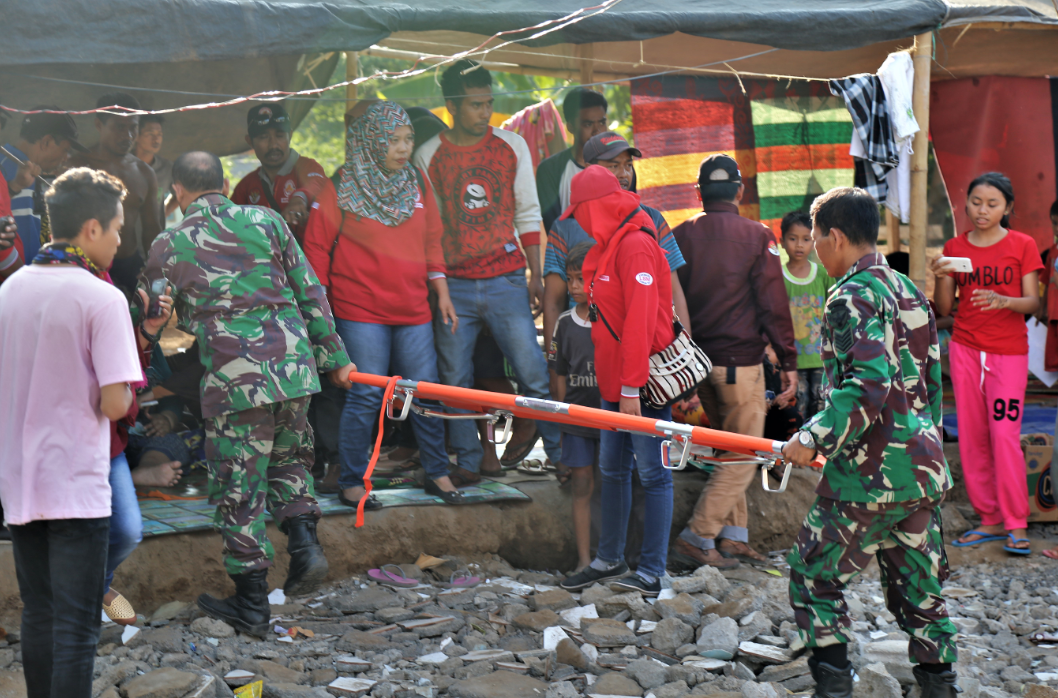 Injured people are being removed and hospitalised after the devastating 2018 Lombok earthquakes